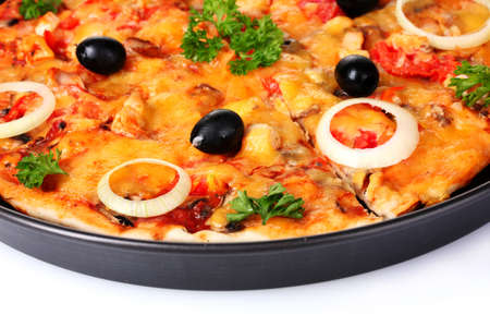 tasty pizza with olives in the pan isolated on white photo