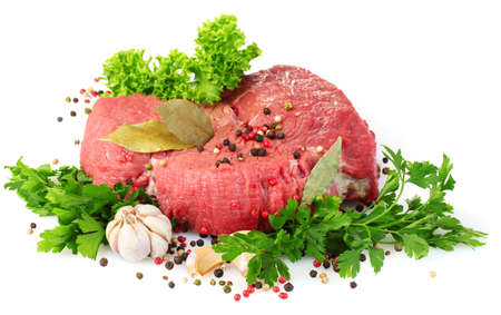 raw meat and spices isolated on white photo
