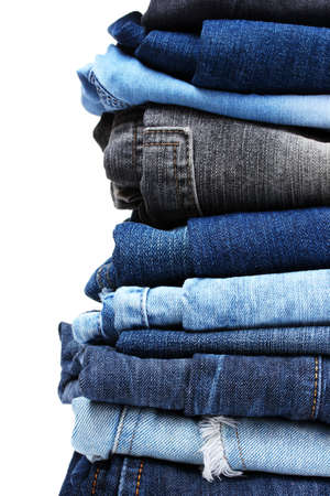 navy blue background: lot of blue jeans isolated on white