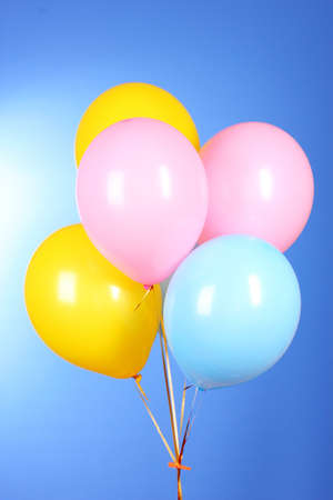 Flying balloons on a blue background Stock Photo - 10220358