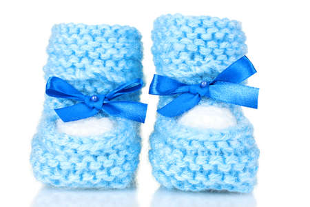 cuddly baby: pink baby booties blue isolated on white