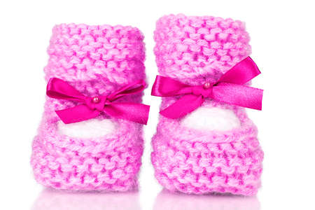 pink baby booties blue isolated on white photo