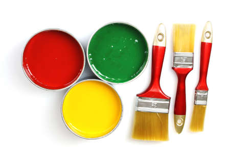 open tin cans with paint and brushes isolated on white Stock Photo - 10295335