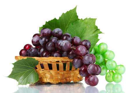 ripe green and red grapes in basket isolated on white photo
