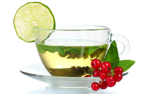 green tea in transparent cup with lime and berry isolated on white Stock Photo - 10295359