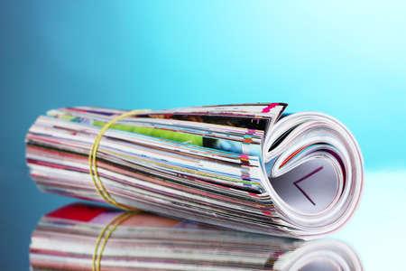 many magazines on blue background photo