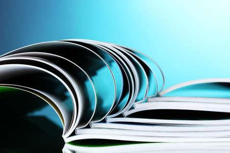 magazine on blue background Stock Photo - 10295469