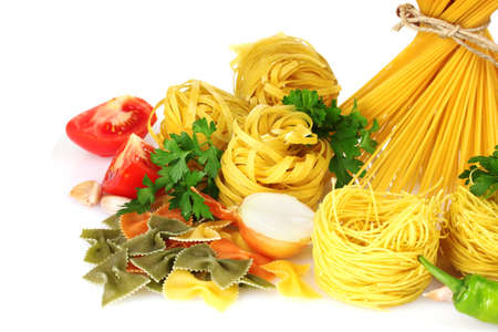 tasty vermicelli, spaghetti and vegetables isolated on white photo