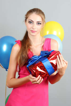 beautiful young girl with a gift in hands Stock Photo - 10324408