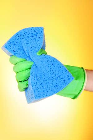 Womans hand holding big sponge photo