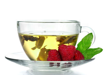 green tea in transparent cup and raspberry isolated on white photo