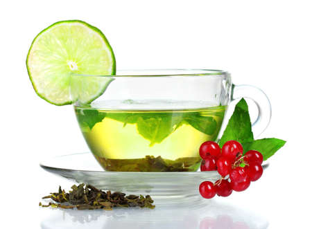green tea in transparent cup with lime and berry isolated on white photo