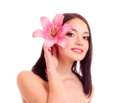 Beautiful young woman with lily flower Stock Photo - 10324427
