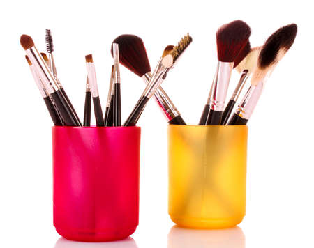cosmetic brushes in cup white photo