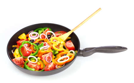 frying: many vegetables in the pan isolated on white
