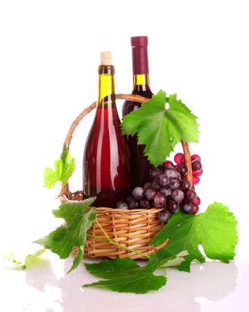 wine and grapes isolated on white photo