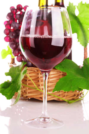 viniculture: wine and grapes isolated on white