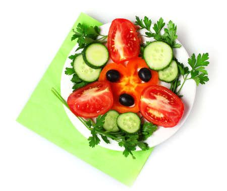 tasty vegetable salad on plate isolated on white photo