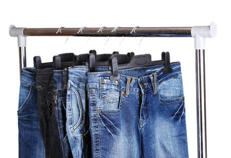 denim wear: jeans on hangers isolated on white