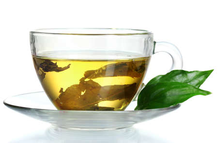 green tea in transparent cup and mint isolated on white Stock Photo - 10327272