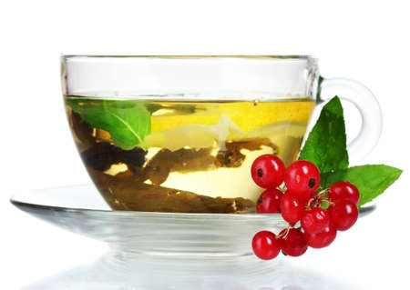 green tea in transparent cup with lemon and berry isolated on white Stock Photo - 10327280