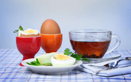 delicious breakfast of boiled eggs and tea photo