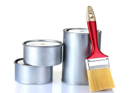 closed tin cans with paint and brush  isolated on white photo