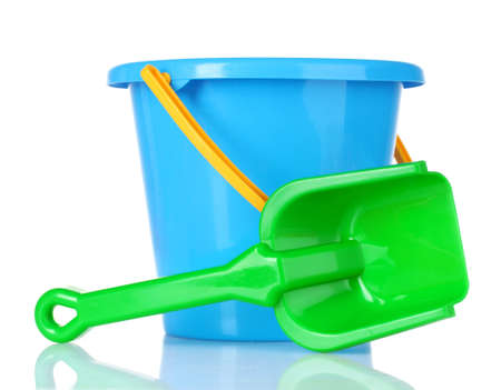 baby toy bucket and shovel isolated on white photo