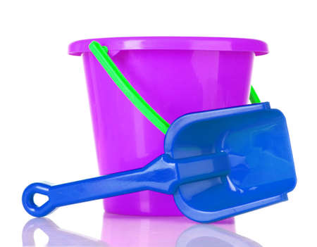baby toy bucket and shovel isolated on white photo