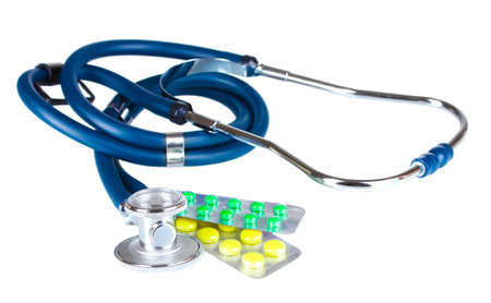 stethoscope and pills isolated on white photo