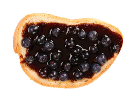 yummy toast with jam and blueberries isolated on white photo
