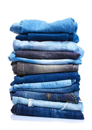 in a pile: lote de pantalones vaqueros aislados en blanco