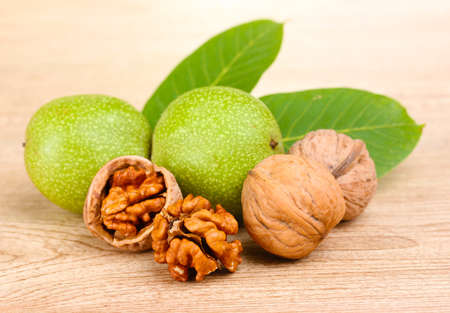 walnut: walnuts and leaves on wooden background
