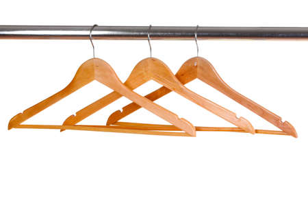 wooden clothes hangers isolated on white photo