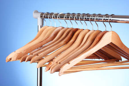 wooden clothes hangers on blue background Stock Photo - 10438049