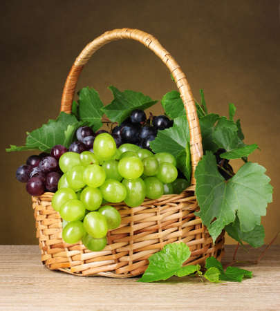 Ripe grapes in a basket on yellow background Stock Photo - 10438013