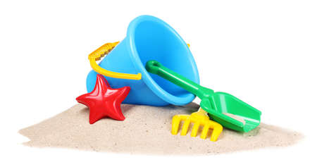 sand toys: childrens beach toys and sand isolated on white