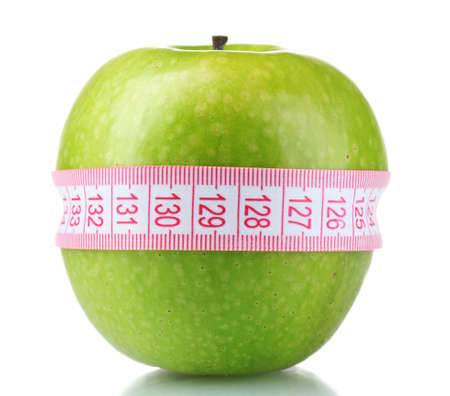 green apple and measuring tape isolated on white photo