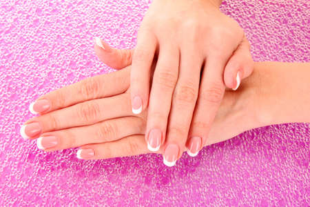 Beautiful woman hands with french manicure on pink background Stock Photo - 10438089