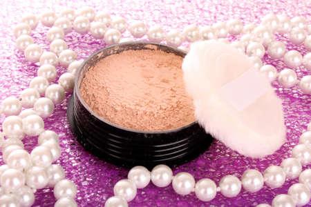 makeup powder on pink background photo