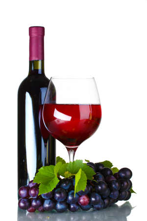 Ripe grapes, wine glass and bottle of wine isolated on white photo
