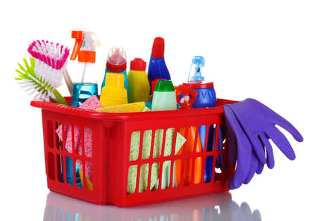 full box of cleaning supplies and gloves isolated on white photo