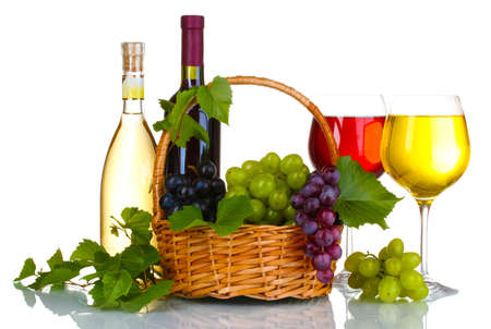 Ripe red grapes and wine in basket isolated on white photo