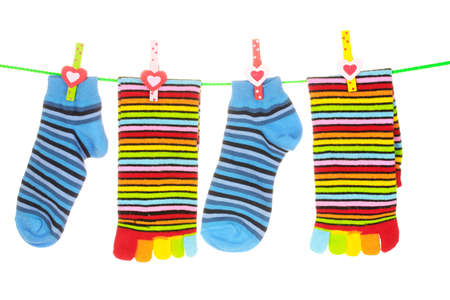 bright  socks on a line is isolated on a white photo