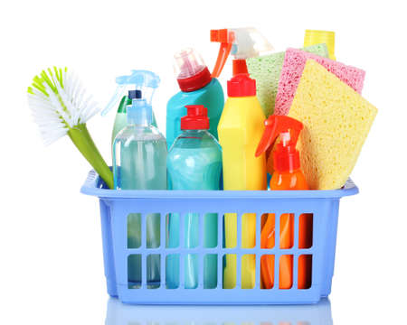 bright housekeeping: full box of cleaning supplies and sponges isolated on white Stock Photo