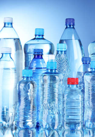 Group plastic bottles of water on blue background Stock Photo - 10518960