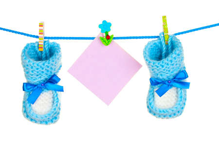 baby socks and booties isolated on white photo