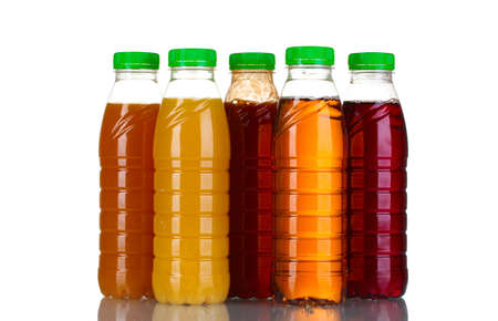 juice squeezer: Bottles with juice isolated on white