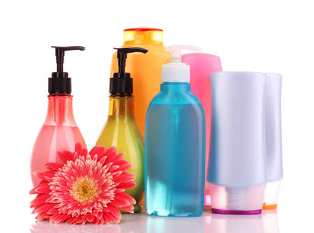 beauty care: bottles of health and beauty products on white background