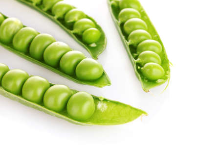green peas isolated on white photo